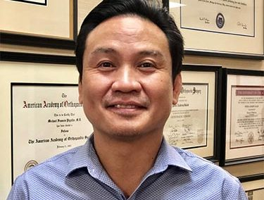 Norman Roque, PT, OCS, CHT, ROT